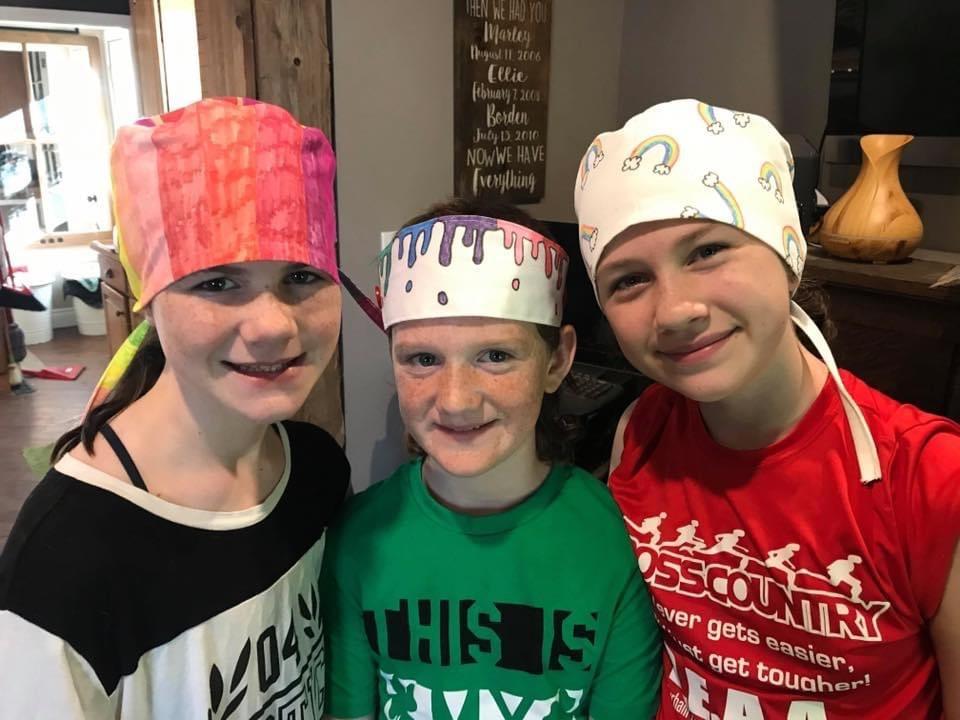 kids wearing scrub caps