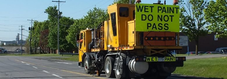 Image of truck doing line painting operations on roads