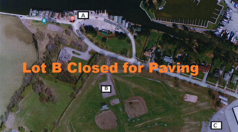 Aerial view of parking lots at Beaverton Harbour - Lot B closed for paving