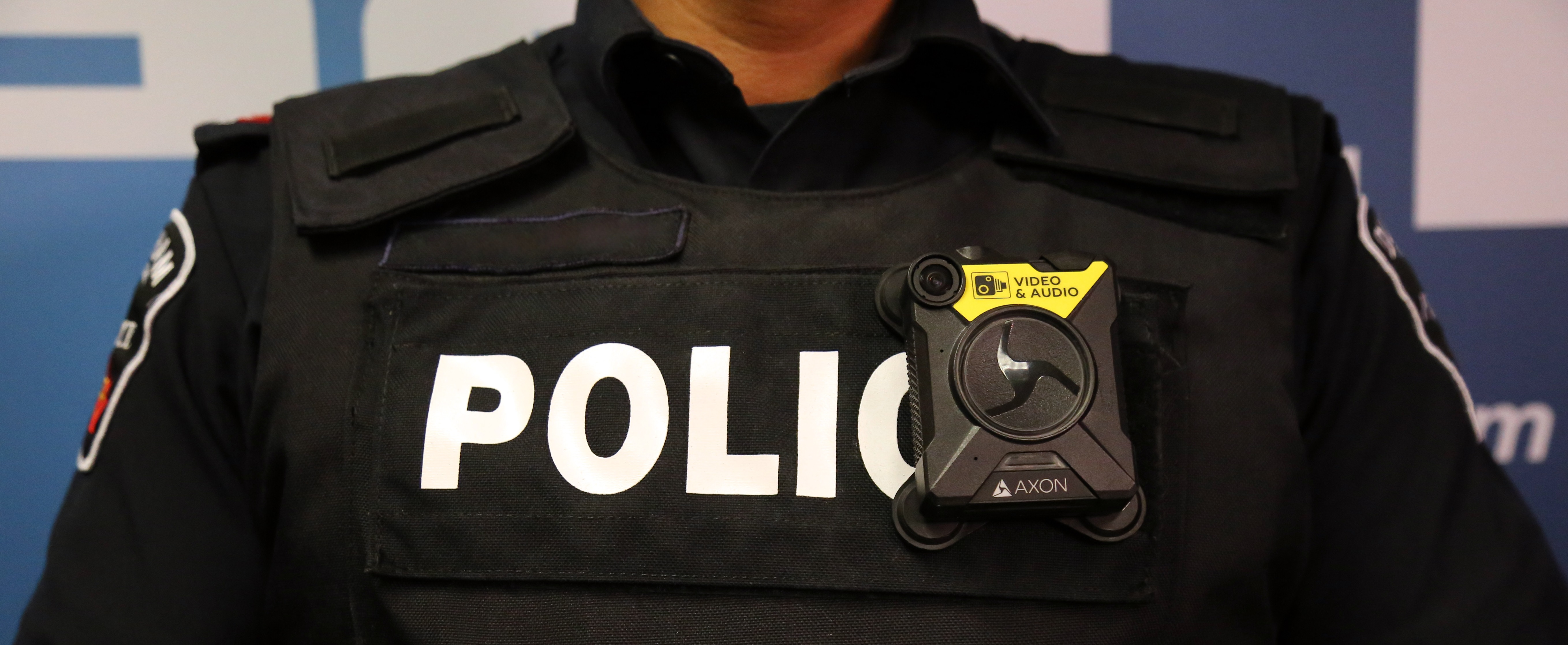 Police Officer wearing bullet proof identifiable vest