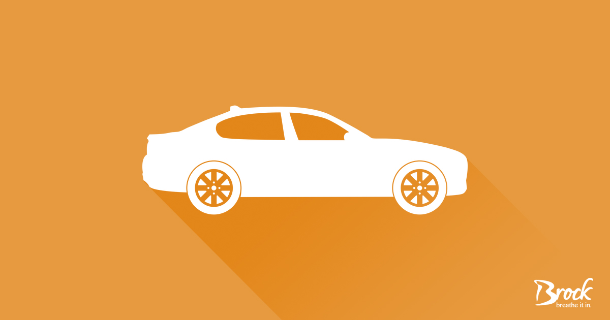 Orange background with white car