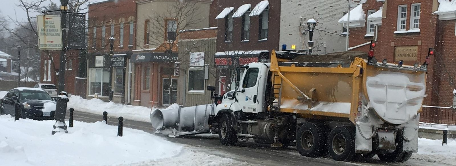 snow plow clearing snow from streets
